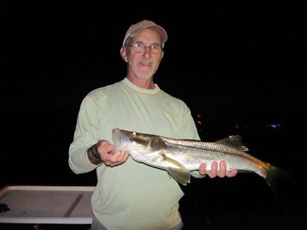 Fly fishing for snook should be a good option on the flats and around dock lights during October. Jon Yenari (top), from Sarasota, and John Lamanna (bottom), from Bradenton, had good action catching and releasing snook on flies while fishing with Capt. Rick Grassett in a previous October.