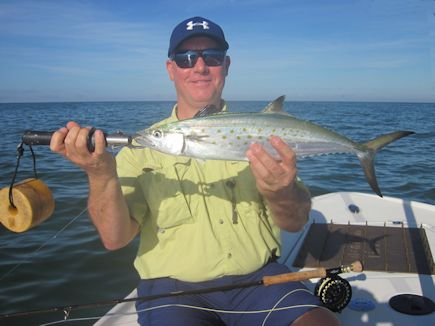 There should be good fly fishing action in the coastal gulf during October. Ken Babineau (top), from Sarasota, caught and released a tripletail and Kirk Grassett (bottom), from Middletown, DE, caught and released Spanish mackerel on flies while fishing the coastal gulf with Capt. Rick Grassett in a previous October.